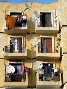 Satellite dishes on balconies of flats