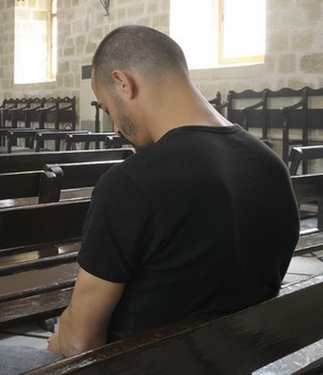 Young man in church (stock photo)