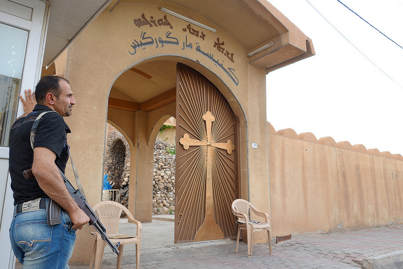 Photo: library image of guard protecting Chaldean Church in Iraqi Kurdistan (Beatrice Dillies, Flickr Commons)