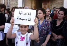 French child with We are Iraqi Christians sign