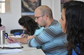 Grace (right) interprets in a class