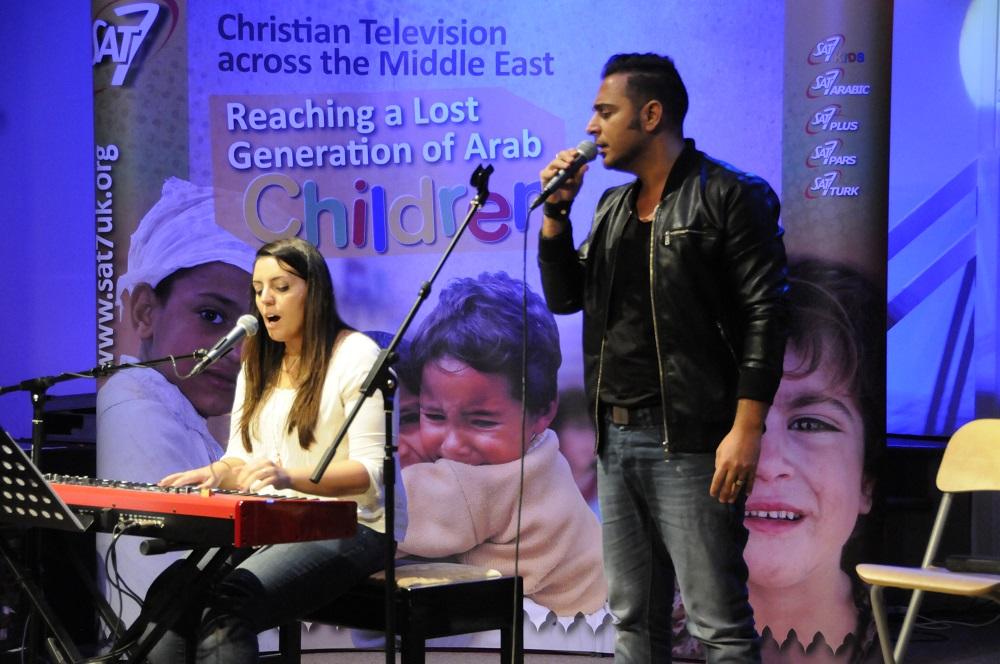 Joyce and Rawad sing