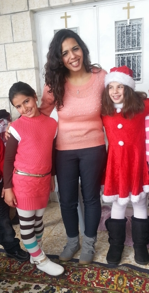 Grace with young friends in Christmas gear