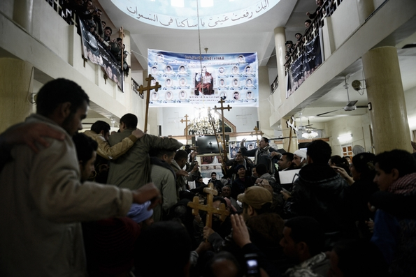 Relatives and residents mourn their family members (see hanging) at Al Aoura church (c) Jonathan Rashad