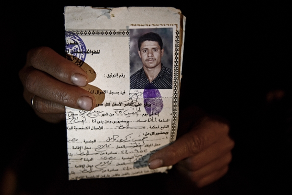 Magda holds her husband, Milad's ID papers