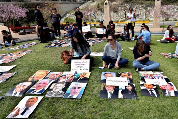April 2014: women urged politicians to enshrine an anti-domestic violence law (Bilal Hussein, AP/PA Images)