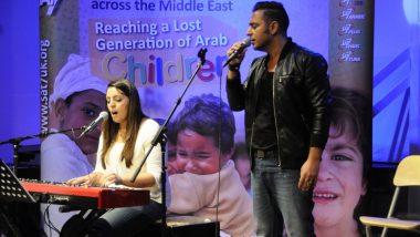 Joyce and Rawad sing at Encounter
