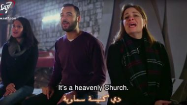 "Two female and one male member of Good News team sing ""Heavenly Church"""