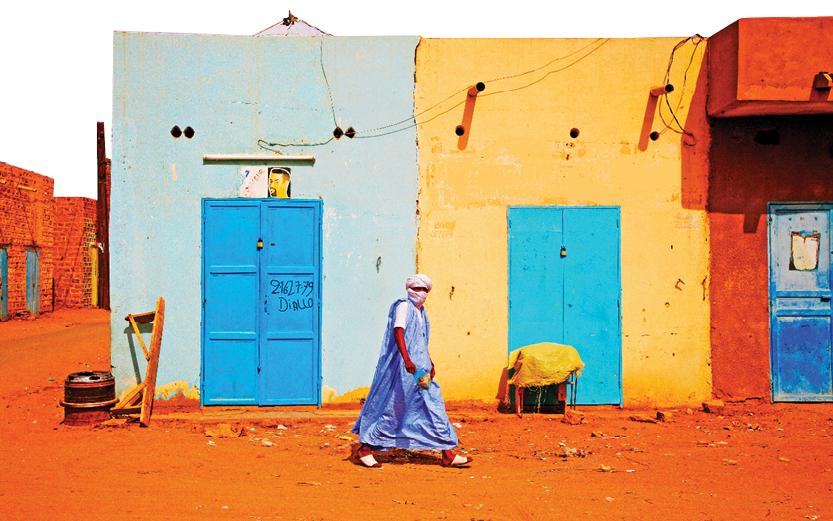 A man walks down the road in Atar, Mauritania (Eric Valenne geostory/Shutterstock)