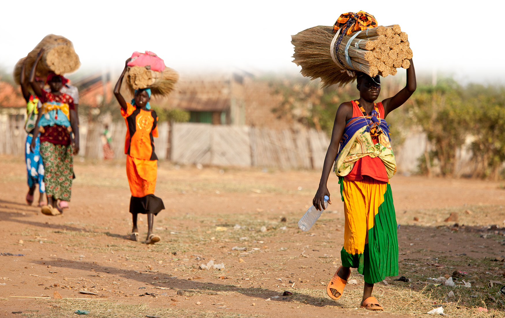 Women carry heavy loads on their heads in Torit, South Sudan (John Wollwerth/Shutterstock)