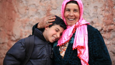 Iranian woman hugs her son