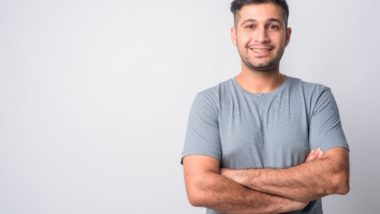 Iranian man standing with folded arms