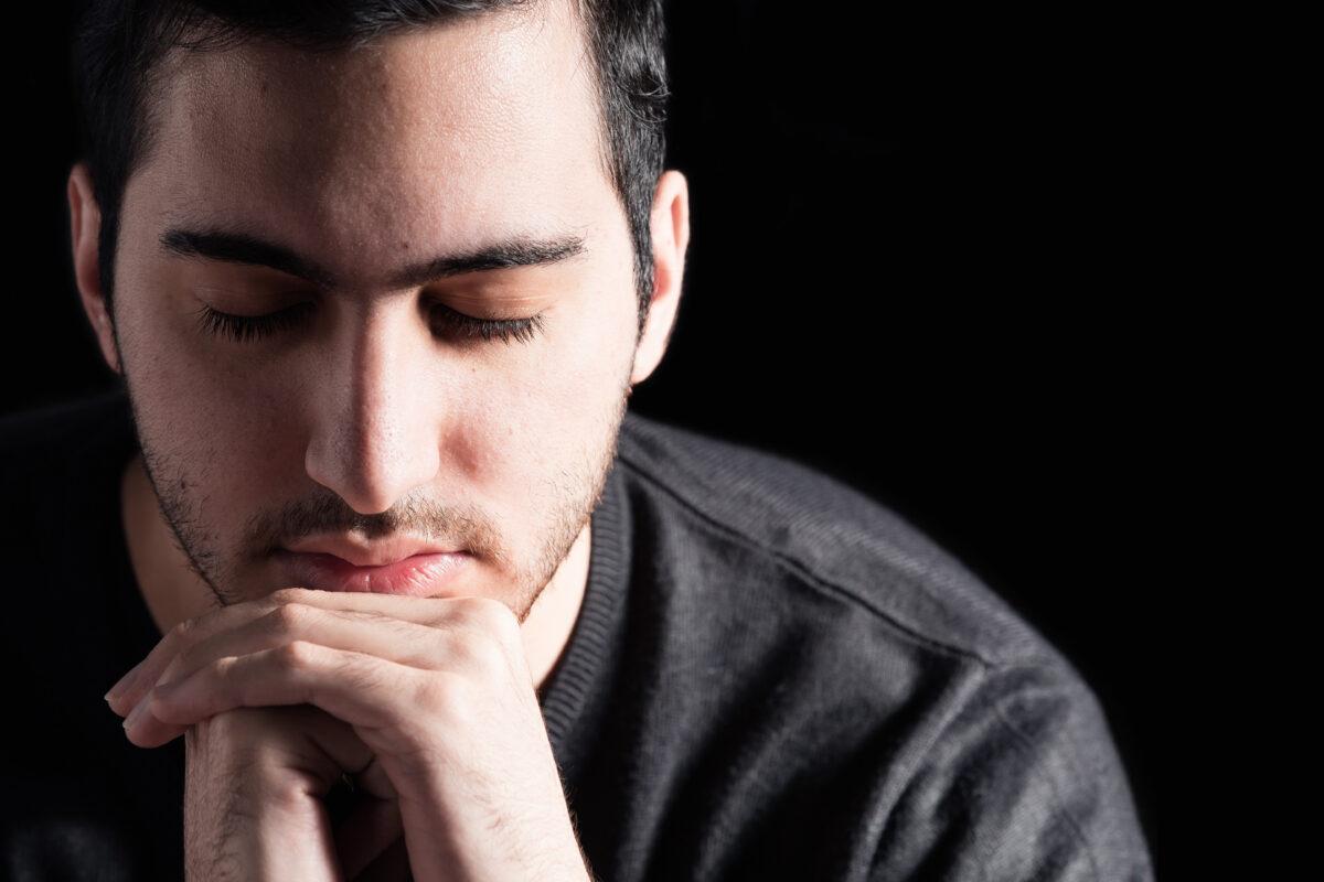 Middle Eastern man praying