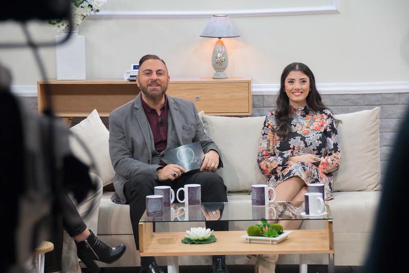 Couple seated on sofa
