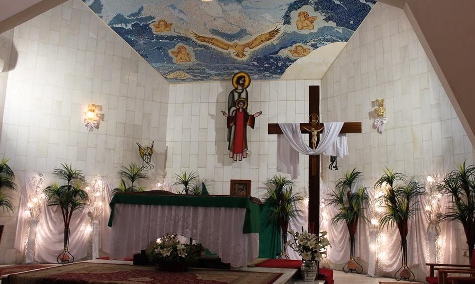 Modern church chancel with white robe draped over cross