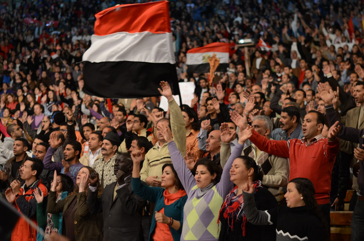 Massive crowd of Christians pray, some waving Egyptian flags