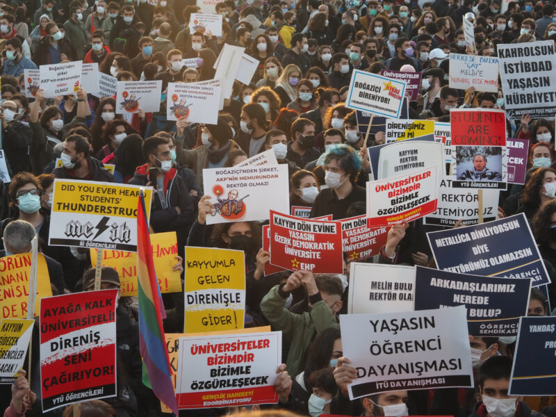 Hundreds of university students protest with banners