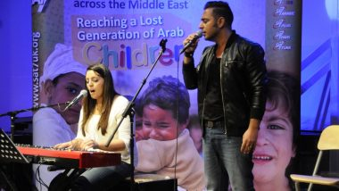Joyce and Rawad sing at Encounter