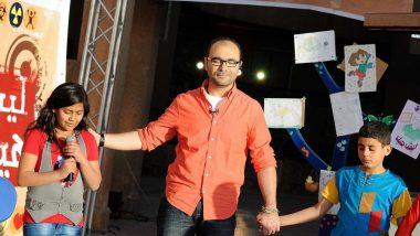 Essam-with-viewer-praying-CROP