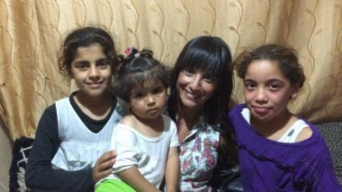 Rita Elmounayer with Syrian child refugees in the Bekaa Valley