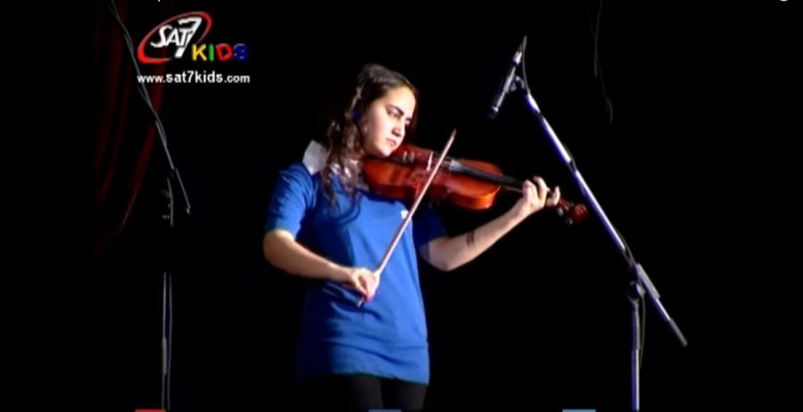 Young girl plays violin