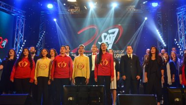 Worship choir sing with SAT-7 20th anniversary backdrop