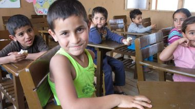 Syrian child refugees in a refugee camp classroom