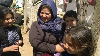Syrian mother and children in Lebanon informal camp
