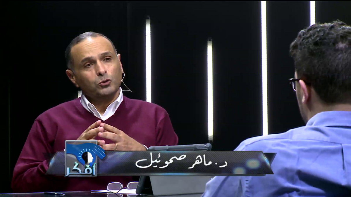 Maher Samuel (left) talks to interviewer (right with back to us) on I Think.)