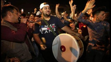 Iraqi Christians celebrate - drummer leads joyful celebrations