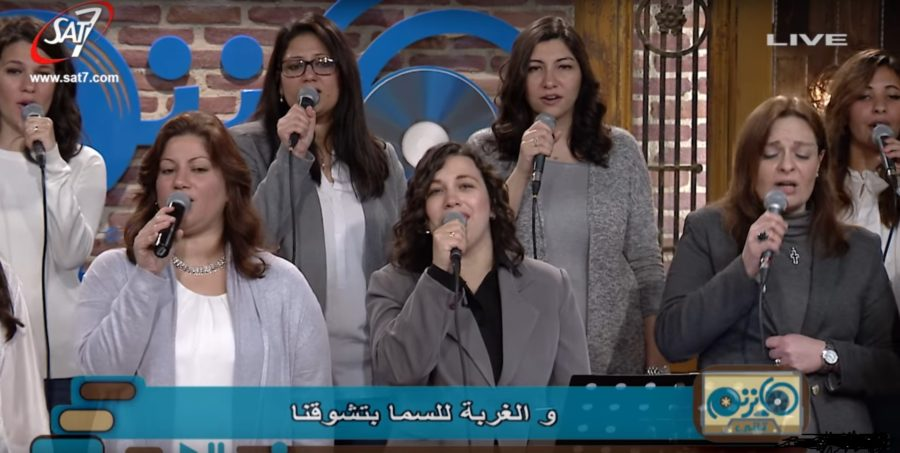 Women members of the Good News team sing praise