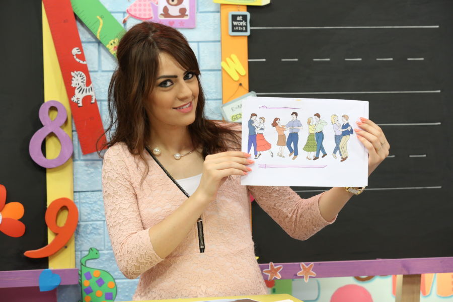 English teacher shows images of people