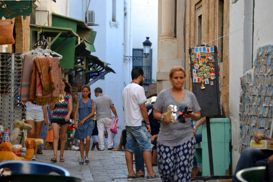 Locals (mainly women) walking in pedestrian street