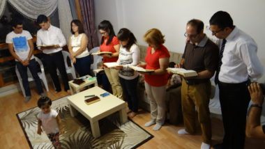 Iranian believers meet to worship at a house church
