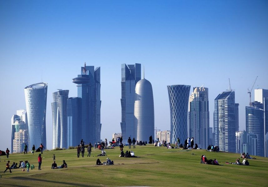 Relaxing in a Central Doha park surrounded by glittering towers (Andrzej Kubik/Shutterstock)