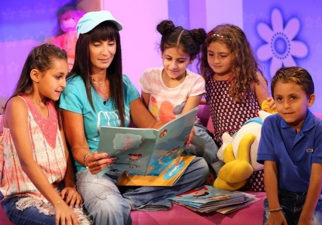 Presenter Rita Elmounayer and children in an episode of Bedtime Stories
